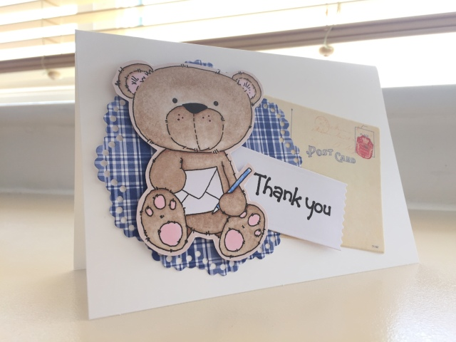 Bear holding thank you letter